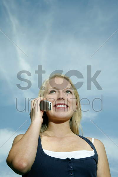 teenage girl talking on the phone stock photo