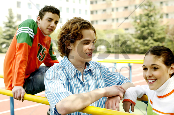 teenagers hanging out at the field after school stock photo