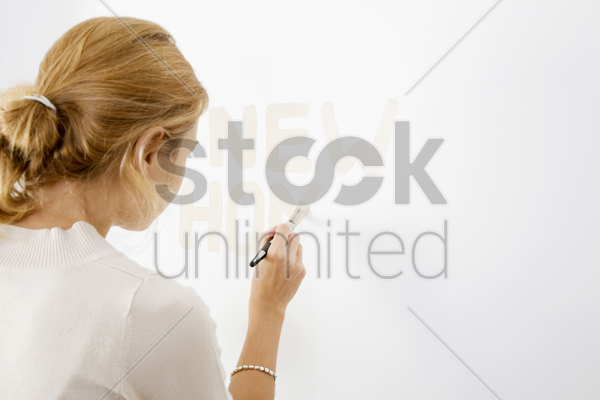 testing paint colour on wall stock photo