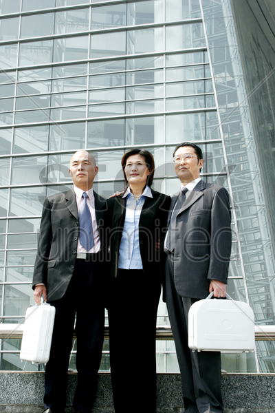 three business people in office attire stock photo