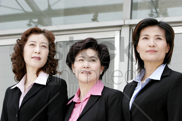 three business women looking away stock photo