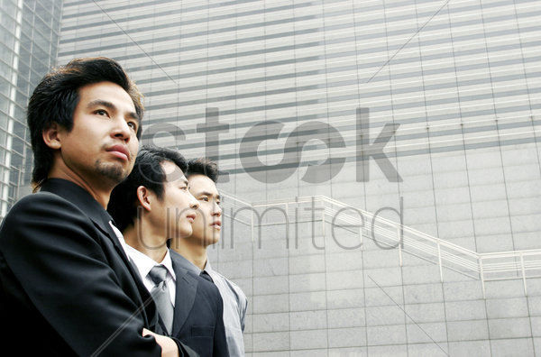 three men in office attires stock photo