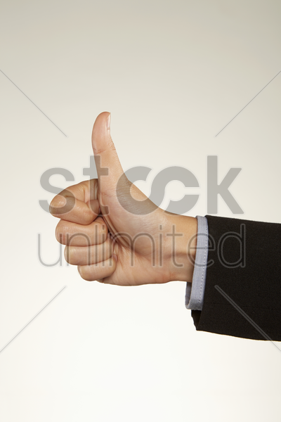 thumbs up hand gesture stock photo