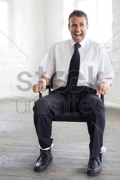 tied up businessman screaming for help stock photo