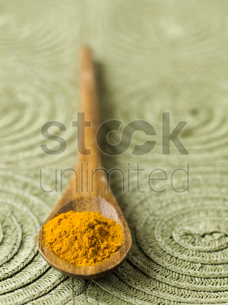turmeric in spoon stock photo