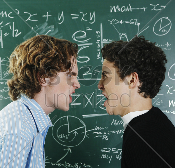 two boys arguing in the classroom stock photo