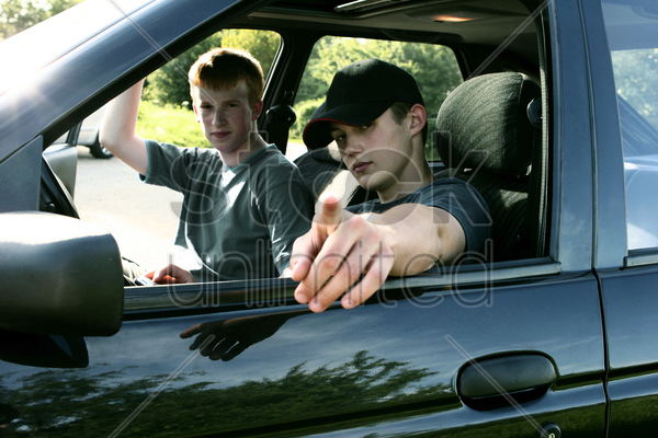two boys sitting in a car stock photo