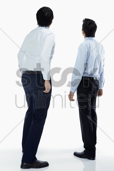 two businessmen looking upwards stock photo