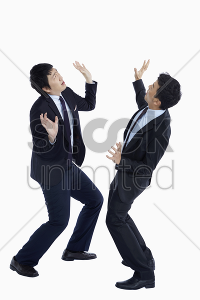 two businessmen looking very shocked stock photo