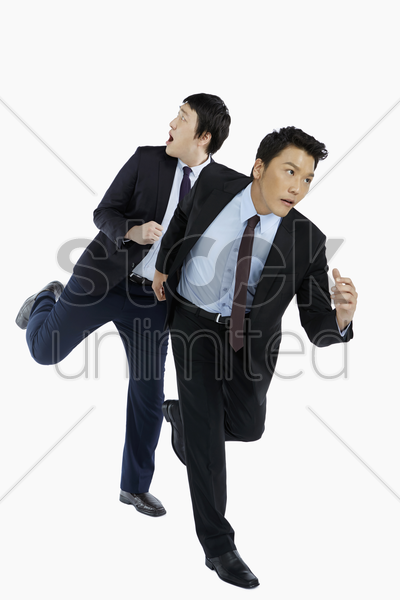 two businessmen on the run stock photo