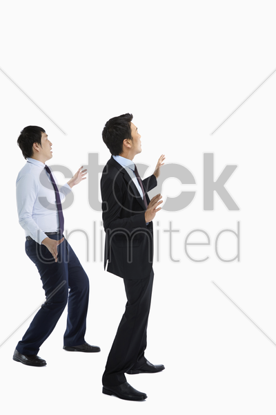 two businessmen showing a shocked reaction stock photo