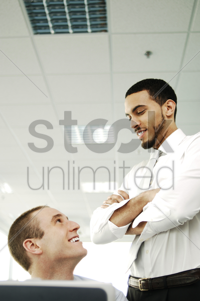 two businessmen talking and smiling stock photo