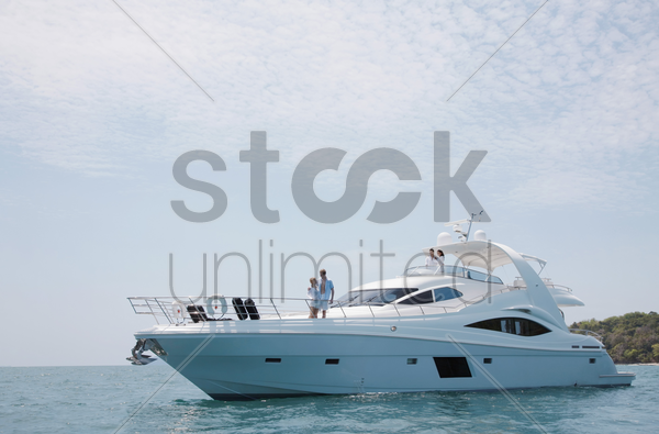 two couples on yacht stock photo