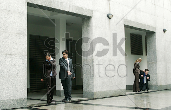 two couples with an abusive husband on one side and an abusive wife on the other side stock photo