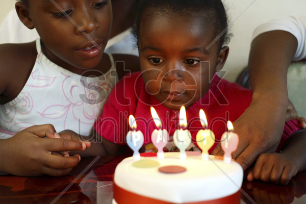 two girls and a birthday cake stock photo