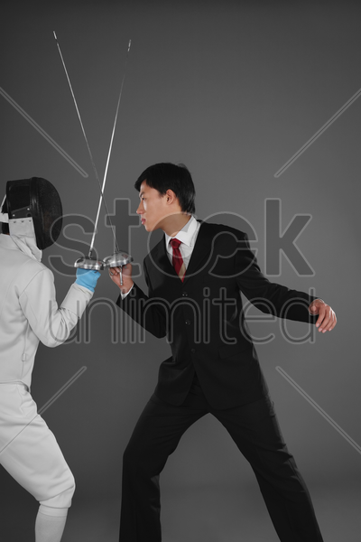 two men dueling stock photo