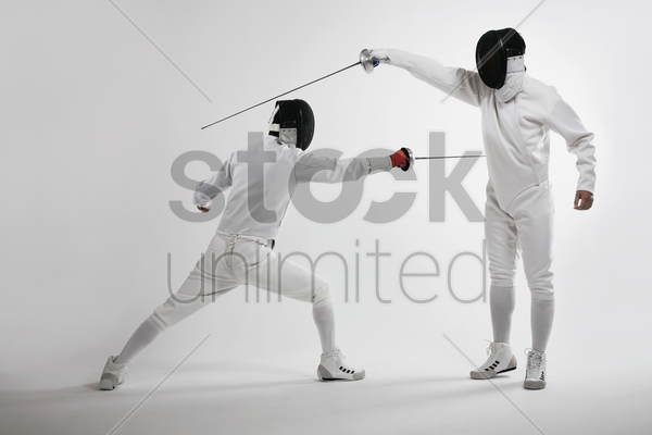two men fencing stock photo