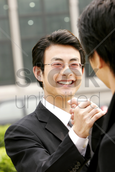 two men greeting in each other stock photo
