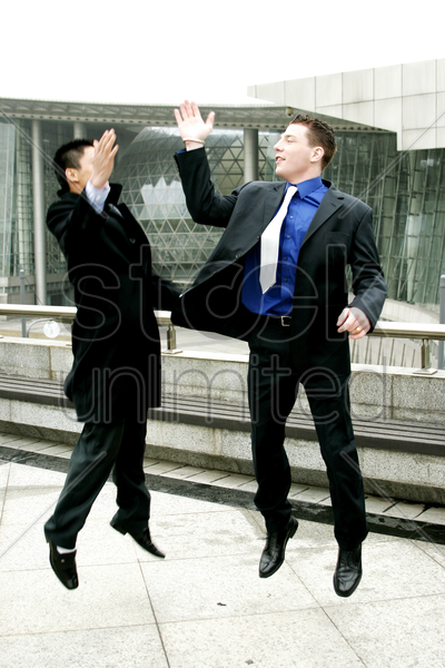 two men in business suit giving high five stock photo