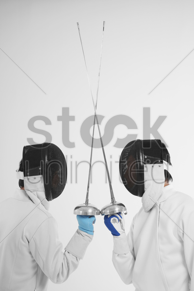 two men in fencing suits in a duel stock photo