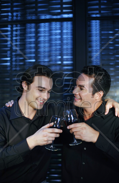 two men proposing a toast stock photo