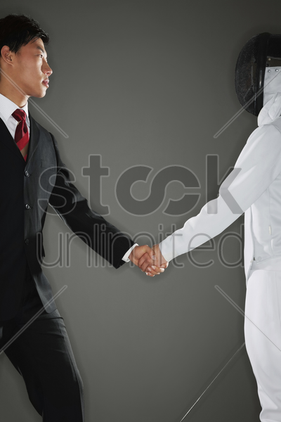 two men shaking hands stock photo