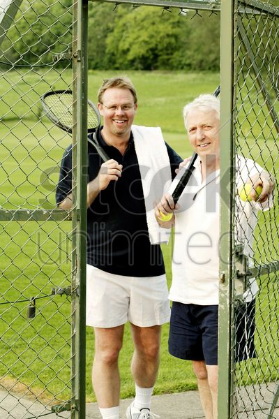 two men with tennis racquet and tennis ball stock photo