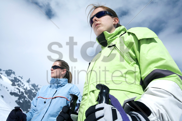 two women getting ready for snow skiing stock photo