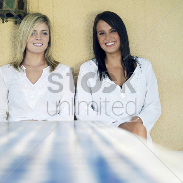 two women smiling stock photo