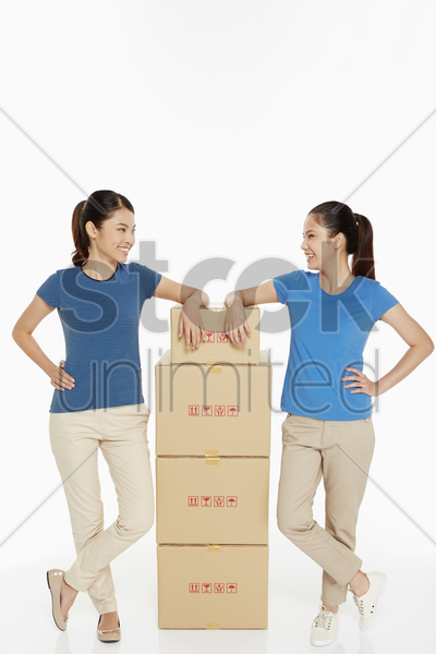 two women standing side by side stock photo