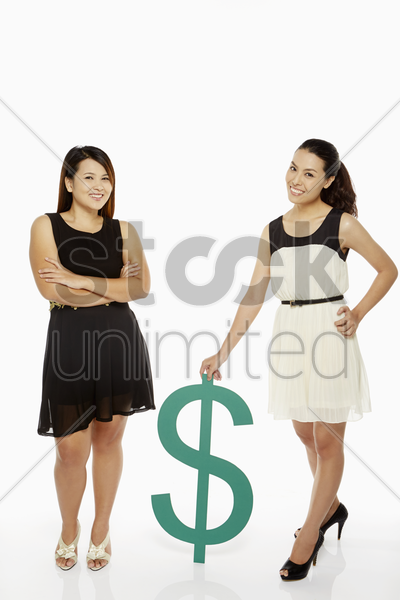 two women with a dollar sign stock photo