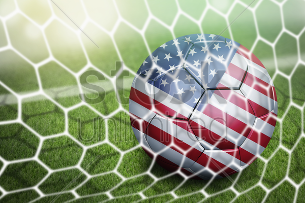 usa soccer ball in goal net stock photo
