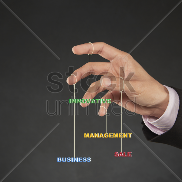 various text hanging on human fingers stock photo