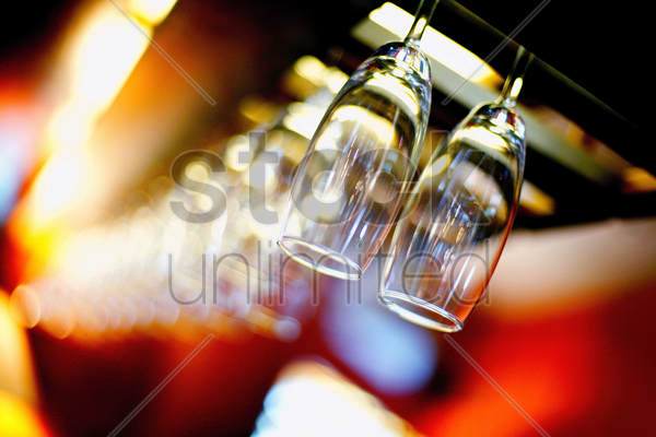 wine glasses hanging in the bar stock photo