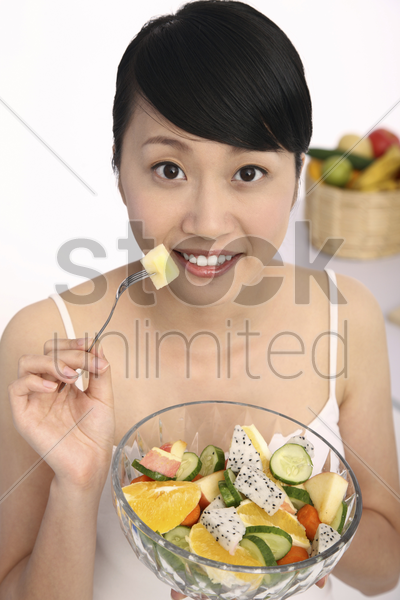 woman about to eat fruit salad stock photo