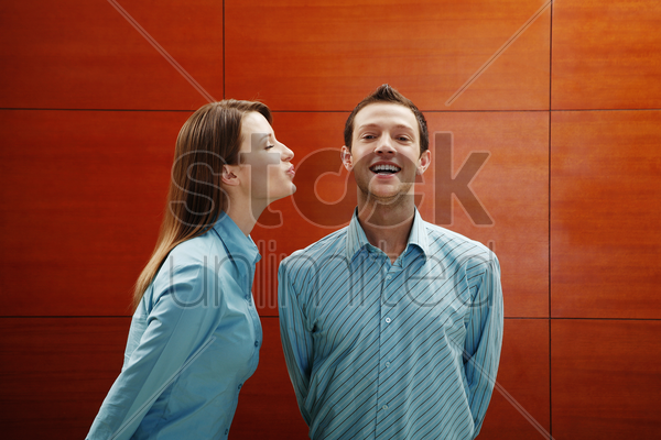 woman about to give man a kiss stock photo