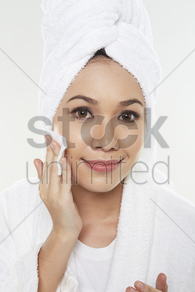 woman applying facial product stock photo
