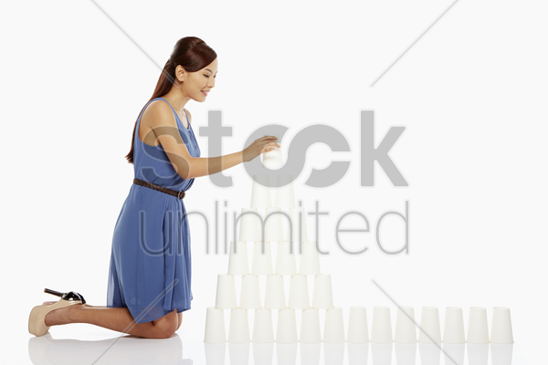 woman arranging disposable cups stock photo