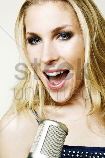 woman belting out a song stock photo