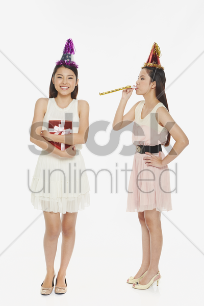 woman blowing a party horn blower stock photo