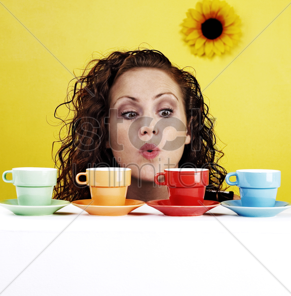 woman blowing her cups of coffee stock photo