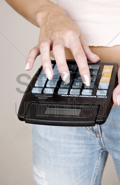 woman calculating with a calculator stock photo