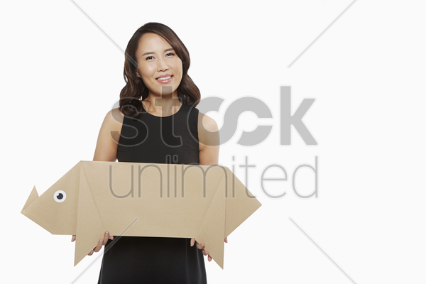 woman carrying a cardboard pig stock photo