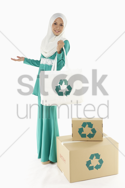 woman carrying a reusable bag stock photo