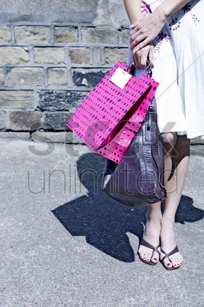 woman carrying bags stock photo