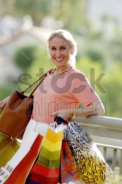 woman carrying paper bags stock photo