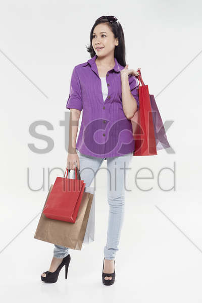 woman carrying shopping bags stock photo