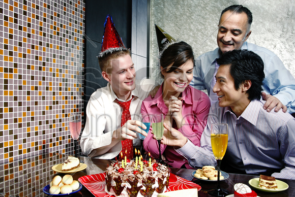 woman celebrating birthday with her friends stock photo