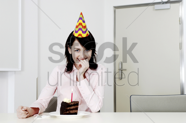 woman celebrating her birthday alone stock photo
