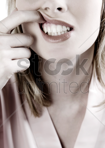 woman checking her gums stock photo